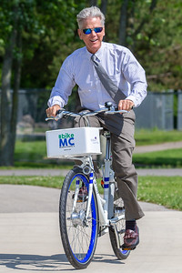 City of Woodstock Mayor Brian Sagar takes a ride on a new Zagster bicycle Friday, June 14, 2019 in McHenry. McHenry County, along with Zagster, launched its new county wide bike share program at the McHenry Recreation Center.  KKoontz- For Shaw Media