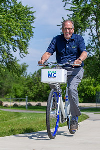 Sam Zito takes a spin along the McHenry County trails on a Zagster bike Friday, June 14, 2019 in McHenry. McHenry County, along with Zagster, launched its new county wide bike share program at the McHenry Recreation Center.  KKoontz- For Shaw Media