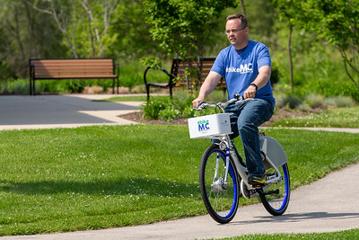 City of McHenry Economic Development Director Doug Martin takes a ride on a new Zagster bicycle Friday, June 14, 2019 in McHenry. McHenry County, along with Zagster, launched its new county wide bike share program at the McHenry Recreation Center.  KKoontz- For Shaw Media