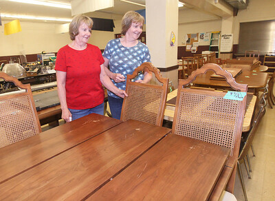 Candace H. Johnson-For Shaw Media Co-chairs Marilyn Sink and her twin sister, Suzanne, both of Ingleside look over the donated furniture for sale as they get ready for the Our Lady of the Lakes St. Bede Rummage Sale at the St. Bede School in Ingleside. Patrick Zwilling, of Lake Villa is also a co-chair. The rummage sale is open June 20-22nd, Thursday and Friday, 9-7 p.m. and Saturday, 9-2 p.m. (6/16/19)