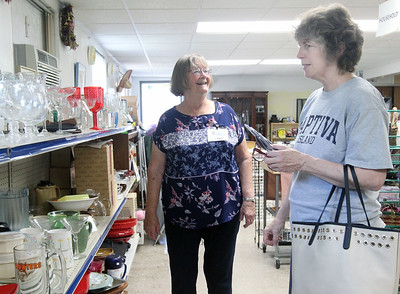 Candace H. Johnson-For Shaw Media Linda Elliott, of Gurnee, church member, helps Kelly McGourty, of Fox Lake as she shops at the Joyful Spirit United Methodist Church's Joyful Abundance Resale Shop in Ingleside. The resale shop is open every Friday and Saturday from 9 a.m. to 1:00 p.m. (6/16/19)