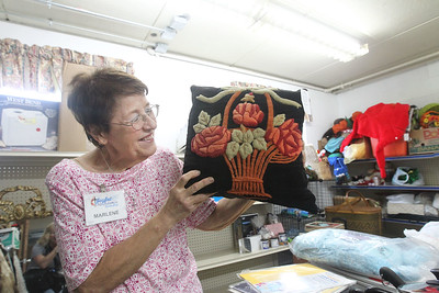 Candace H. Johnson-For Shaw Media Marlene Hoppe, of Bristol, Wis., shows off a pillow that her grandmother, Matilda Mollenhauer, made and that she has donated to sell it at the Joyful Spirit United Methodist Church's Joyful Abundance Resale Shop in Ingleside. The resale shop is open every Friday and Saturday from 9 a.m. to 1:00 pm. (6/16/19)