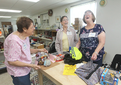 Candace H. Johnson-For Shaw Media Church friends Marlene Hoppe, of Bristol, Wis., Laura Grant, of Fox Lake and Linda Elliott, of Gurnee share a laugh as they help out at the Joyful Spirit United Methodist Church's Joyful Abundance Resale Shop in Ingleside. (6/16/19)