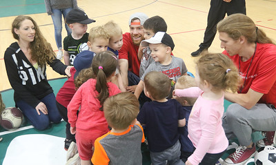 Candace H. Johnson-For Shaw Media Coaches Matt Canale, of Carpentersville and Matthew Leyva, of Lindenhurst bring 2-3 year olds together in a huddle for a cheer at the end of practice during 5 Star Pee Wee Soccer at the Wauconda Park District Community Center. (6/16/19)