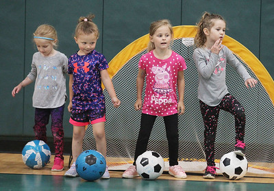 "Candace H. Johnson-For Shaw Media Leah Goodall, 4, of Port Barrington, Gia Valenziano, 4, of Wauconda,  Kyleigh Tournas, 5, of Volo and    Sarah Goodall, 5, of Port Barrington play ""Red Light, Green Light,"" as they learn how to dribble their soccer balls during 5 Star Pee Wee Soccer for 4-6 year-olds at the Wauconda Park District Community Center. (6/16/19)"