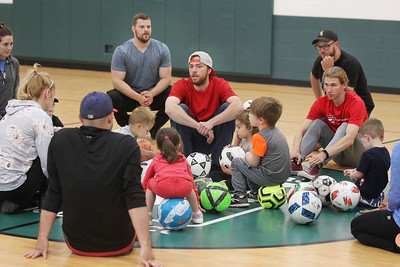 Candace H. Johnson-For Shaw Media Coach Matt Canale, of Carpentersville (center) talks with a group of 2-3 year olds as they sit with their parents about passing and dribbling the ball, skills they learned, during 5 Star Pee Wee Soccer at the Wauconda Park District Community Center. (6/16/19)