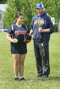 Candace H. Johnson-For Shaw Media Shug Uye, 12, of Antioch listens to Kevin Holtz, of Crystal Lake, coach, as he talks about fielding the ball during the Antioch Parks and Recreation Hot Shots Sports softball clinic at Trevor Creek Park in Antioch. (6/22/19)
