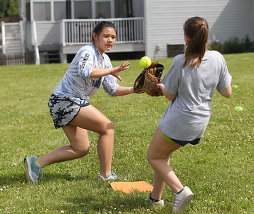 Candace H. Johnson-For Shaw Media Ligaya Molene catches a ball thrown by Sophia Dean, both 12, of Antioch as they play a game during the Antioch Parks and Recreation Hot Shots Sports softball clinic at Trevor Creek Park in Antioch. (6/22/19)