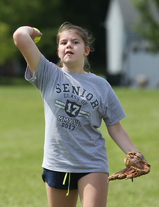 Candace H. Johnson-For Shaw Media Sophia Dean, 12, of Antioch throws the ball during the Antioch Parks and Recreation Hot Shots Sports softball clinic at Trevor Creek Park in Antioch. (6/22/19)