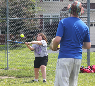 Candace H. Johnson-For Shaw Media Marikit Molene, 10, of Antioch practices hitting as she connects on a pitch thrown by Brendon Rose, of Grayslake, coach, during the Antioch Parks and Recreation Hot Shots Sports softball clinic at Trevor Creek Park in Antioch. (6/22/19)