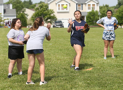Candace H. Johnson-For Shaw Media Sophia Dean throws the ball to Ligaya Molene, both 12, of Antioch as they play a game during the Antioch Parks and Recreation Hot Shots Sports softball clinic at Trevor Creek Park in Antioch. (6/22/19)