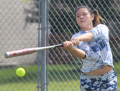 Candace H. Johnson-For Shaw Media Ligaya Molene, 12, of Antioch connects on a pitch as she practices hitting during the Antioch Parks and Recreation Hot Shots Sports softball clinic at Trevor Creek Park in Antioch. (6/22/19)
