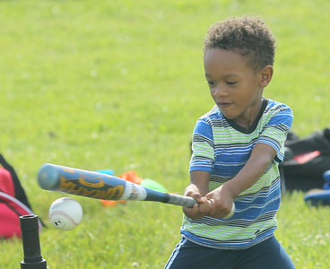 Candace H. Johnson-For Shaw Media Kashmeir Clark, 4, of Antioch looks to connect on a swing during a Antioch Parks and Recreation Hot Shots Sports T-Ball session at Trevor Creek Park in Antioch. (6/22/19)