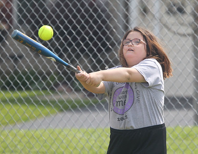 Candace H. Johnson-For Shaw Media Marikit Molene, 10, of Antioch practices hitting as she connects on a pitch during the Antioch Parks and Recreation Hot Shots Sports softball clinic at Trevor Creek Park in Antioch. (6/22/19)