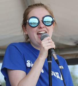 Candace H. Johnson-For Shaw Media Grayslake North's Lily Pinkowski, 17, of Grayslake with the band, Slam Funk, sings a Motown song during the Grayslake Arts Festival in downtown Grayslake. (6/22/19)