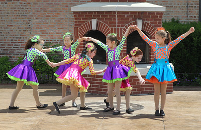 "Candace H. Johnson-For Shaw Media Dancers from the Dance Connection dressed as Munchkins perform a ""Wizard of Oz"" themed dance routine during the Grayslake Arts Festival in downtown Grayslake. (6/22/19)"