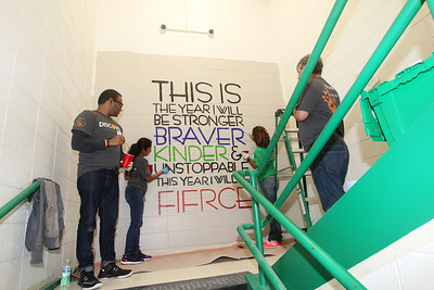Candace H. Johnson-For Shaw Media Volunteers Prasad Paravatha, of Chicago, Priya Krishnamoorthy, of Hawthorn Woods, Quinn Yost, of Des Plaines and Ja'Melah Roberts, of Chicago paint a mural in the stairway during the Discover Business Technology and Volunteer Day at Gavin South Middle School in Ingleside. Over 500 volunteers from Discover Financial Services came to Gavin South to help at the event. (6/20/19)