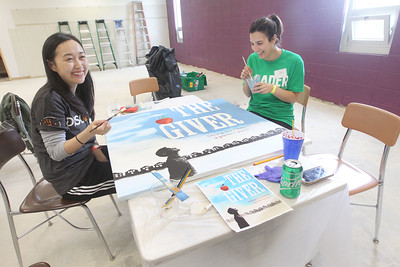 Candace H. Johnson-For Shaw Media Volunteers Jessie Xia, of Northbrook and Nicole Granato, of Wauconda paint a mural for the school library during the Discover Business Technology and Volunteer Day at Gavin South Middle School in Ingleside. Over 500 volunteers from Discover Financial Services came to Gavin South to help at the event. (6/20/19)