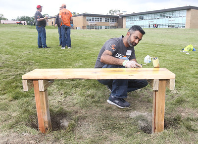 Candace H. Johnson-For Shaw Media Volunteer Ravish Kamath, of Buffalo Grove varnishes a bench for the outdoor classroom in the back of the school during the Discover Business Technology and Volunteer Day at Gavin South Middle School in Ingleside. Over 500 volunteers from Discover came to Gavin South to help at the event. (6/20/19)