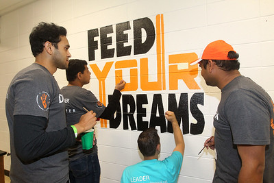 Candace H. Johnson-For Shaw Media Volunteers Arif Khan, of Naperville, Dharmesh Kar, of Schaumberg, Steve Sinchak, of Buffalo Grove and Bhargav Nachegari, of Chicago paint a mural in the cafeteria during the Discover Business Technology and Volunteer Day at Gavin South Middle School in Ingleside. Over 500 volunteers from Discover Financial Services came to Gavin South to help at the event. (6/20/19)