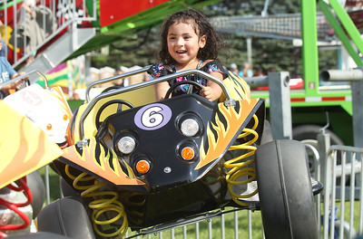 Candace H. Johnson-For Shaw Media Alexa Ortego, 3, of Island Lake goes on the Baja Buggy ride during the Island Lake Carnival at Water Tower Park in Island Lake. (6/22/19)