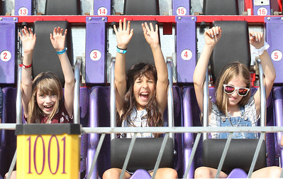 Candace H. Johnson-For Shaw Media Emma Mintun, 8, of Island Lake, Alyssia Aguilar, 9, of Des Plaines and Leah Rieke, 10, of Cary enjoy the Ali Baba ride during the Island Lake Carnival at Water Tower Park in Island Lake. (6/22/19)