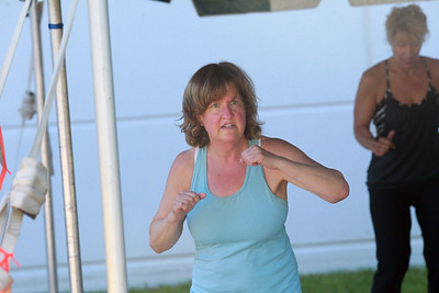 Candace H. Johnson-For Shaw Media Lisa Levinson, of Lake Villa works out during the Gurnee Park District's Boot Camp at FitNation in Gurnee. (6/6/20)