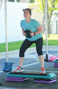 Candace H. Johnson-For Shaw Media Amanda Theron, of Gurnee uses a weight as she works out during the Gurnee Park District's Boot Camp at FitNation in Gurnee. (6/6/20)