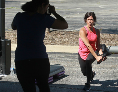 Candace H. Johnson-For Shaw Media Dina Pryhocki, of Lake Villa, instructor, leads fitness members using weights during the Gurnee Park District's Boot Camp at FitNation in Gurnee. (6/6/20)