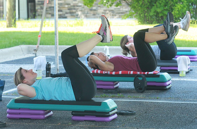 Candace H. Johnson-For Shaw Media Amanda Theron works out a safe distance from Phyllis Milz, both of Gurnee and other fitness members during the Gurnee Park District's Boot Camp at FitNation in Gurnee. (6/6/20)