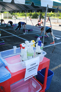 Candace H. Johnson-For Shaw Media Every fitness member has a disinfectant and microfiber towel while working out during the Gurnee Park District's Boot Camp at FitNation in Gurnee. (6/6/20)