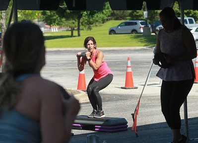 Candace H. Johnson-For Shaw Media Dina Pryhocki, of Lake Villa, fitness instructor, leads fitness members with weights as they work out during the Gurnee Park District's Boot Camp at FitNation in Gurnee. (6/6/20)