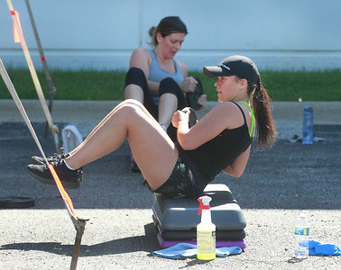 Candace H. Johnson-For Shaw Media Heather Filipowicz, of Gurnee and Katie McDonald, of Waukegan (in front) work with weights during the Gurnee Park District's Boot Camp at FitNation in Gurnee. (6/6/20)