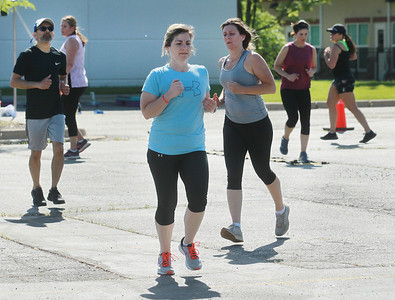 Candace H. Johnson-For Shaw Media Amanda Theron, of Gurnee (center) works out with other fitness members during the Gurnee Park District's Boot Camp at FitNation in Gurnee. (6/6/20)