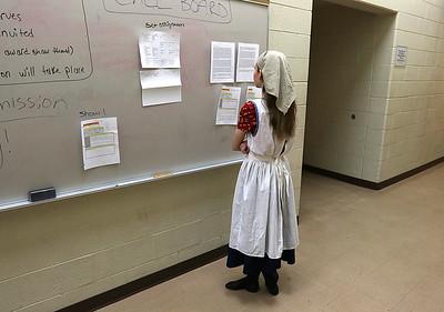 "H. Rick Bamman - hbamman@shawmedia.com Huntley High School's Anna Skala checks the ""Call Board"" backstage before the Fiddler on the Roof rehearsal on Wed. May 13, 2015."