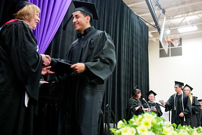 Michelle LaVigne/ For Shaw Media Jose Juarez accepts his associates degree in Robotic Systems Engineering Technology from trustee Molly Wash during Spring Commencement at McHenry County College in Crystal Lake on Saturday, May 16, 2015. Michelle LaVigne/ For Shaw Media