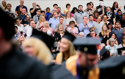 Michelle LaVigne/ For Shaw Media Friends and family are invited to stand and congratulate the gradates of 2015 during Spring Commencement at McHenry County College in Crystal Lake on Saturday, May 16, 2015. Michelle LaVigne/ For Shaw Media