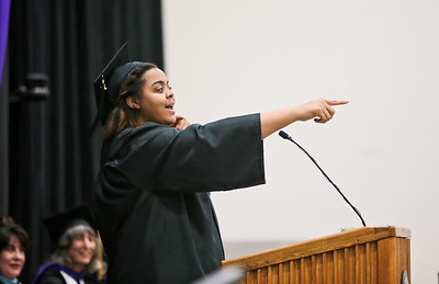 Michelle LaVigne/ For Shaw Media During Jasmine Brown's student presentation she addresses some of her mother's comments she heard as she was working towards getting her degree. Brown delivered her speech during the Spring Commencement at McHenry County College in Crystal Lake on Saturday, May 16, 2015. Michelle LaVigne/ For Shaw Media