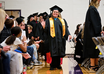 Michelle LaVigne/ For Shaw Media Julie Furman, receiving an associates degree in science, waves to her friends and family as she enters the multi-purpose room for Spring Commencement at McHenry County College in Crystal Lake on Saturday, May 16, 2015.