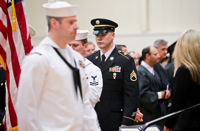 Michelle LaVigne/ For Shaw Media Jason Memmen marches with the color guard as they prepare to present the American Flag during Spring Commencement at McHenry County College in Crystal Lake on Saturday, May 16, 2015. Memmen also serves as the student trustee on the McHenry County College board of trustees.