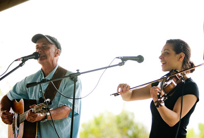 """Michelle LaVigne/ For Shaw Media Singer, songwriter and """"canoe enthusiast,"""" Jerry Vandiver sings """"Any bad day on the water is better than any good day at work,"""" along with fiddling accompaniment by Amberly Rosen of Nashville, Tenn., during the Paddle in the Park event in the Hollows Conversation Area in Cary on Saturday, May 16, 2015."""