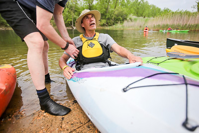 Michelle LaVigne/ For Shaw Media Roger Bennett of Sleepy Hollow tries out a new kyak during the Paddle in the Park event in the Hollows Conversation Area in Cary on Saturday, May 16, 2015.