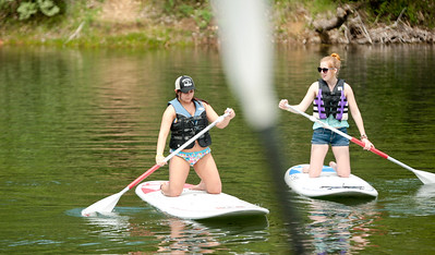 Michelle LaVigne/ For Shaw Media Megan Caroff  (left,) and Grace Pifke both of Antioch try out paddle boarding during the Paddle in the Park event in the Hollows Conversation Area in Cary on Saturday, May 16, 2015.