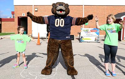 Chicago Bears mascot Staley Da Bear led Westwood Elementary School students in warm up calisthenics before the school's Field Days. H. Rick Bamman - hbamman@shawmedia.com