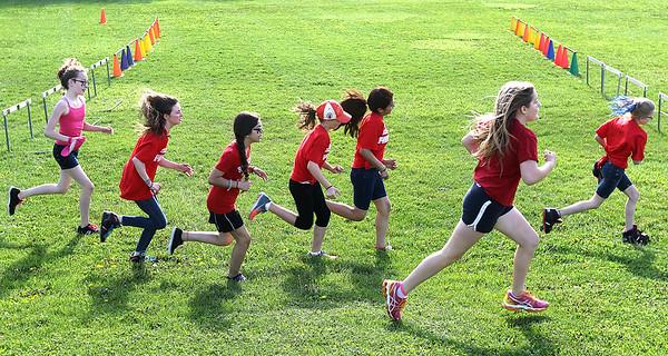 Westwood Elementary School students run the 1/4 mile during the school's Field Days. H. Rick Bamman - hbamman@shawmedia.com