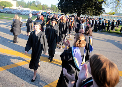 Michelle LaVigne/ For Shaw Media The graduating seniors of McHenry-East High School walk towards McCracken Field in-between the row of District 156 faculty members during McHenry High School-East Campus' Commencement in McHenry on Thursday, May 21, 2015.
