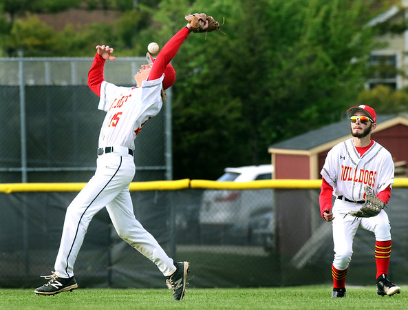 Batavia second baseman Michael Downs fails to catch a fly ball during a game against visiting Geneva May 4.
