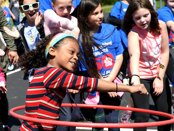 Wild Rose Elementary School third grader Angelena Valerio whips and nae naes during the last round of the hoola hooping competition May 6 at Wild Rose Elementary School's 50th anniversary celebration. The celebration had a fun run, hoola hooping contest and raffles.