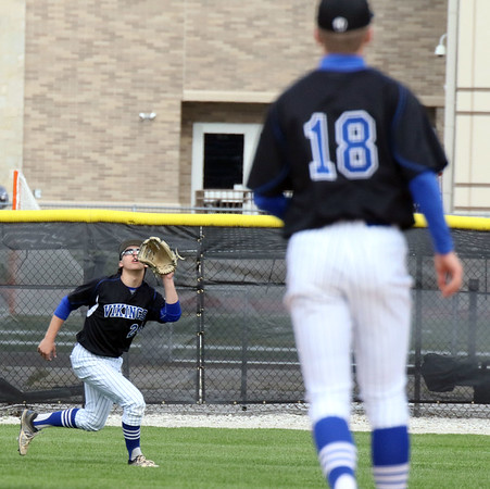 Geneva right fielder Jack Olson prepares to catch a fly ball during a game at Batavia May 4.