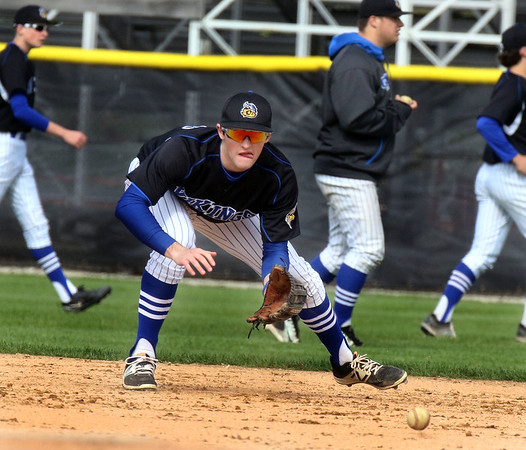 Geneva's Dom Guido fields an infield ground ball during warmups at Batavia May 4.